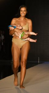 Model breastfeeds her daughter on the Sports Illustrated runway