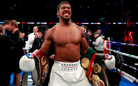 joshua retains titles knocks out povetkin after seven rounds