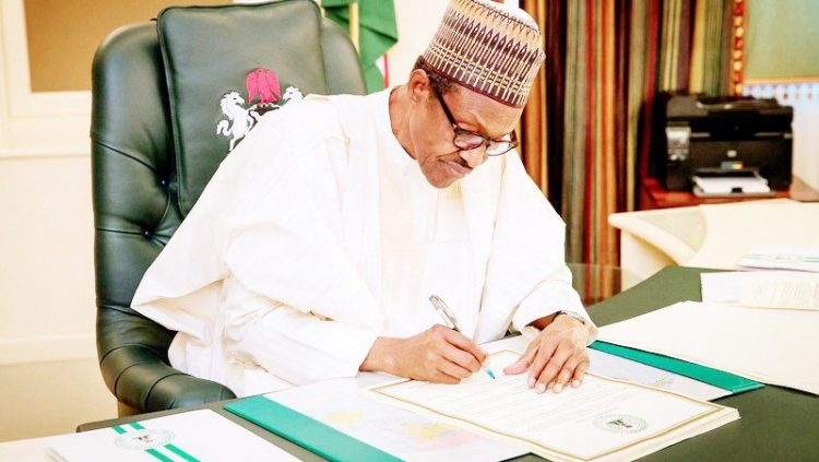 At last, Buhari signs Minimum Wage Bill into law