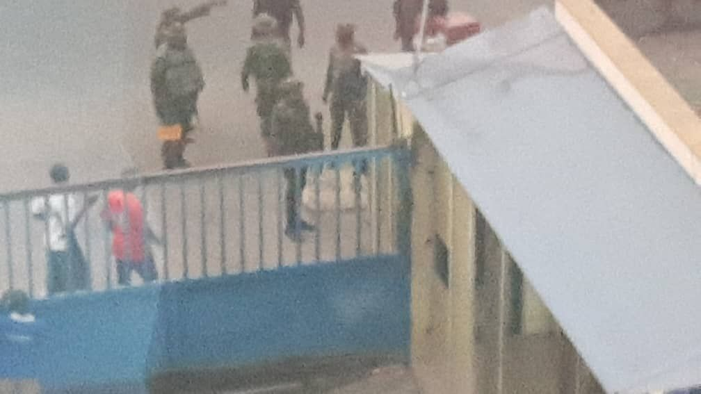 Armed soldiers shut Daily Trust, arrest Editor, reporter