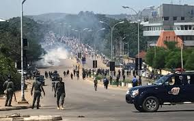 Channels TV reporter shot as police, Shiite group clash in Abuja