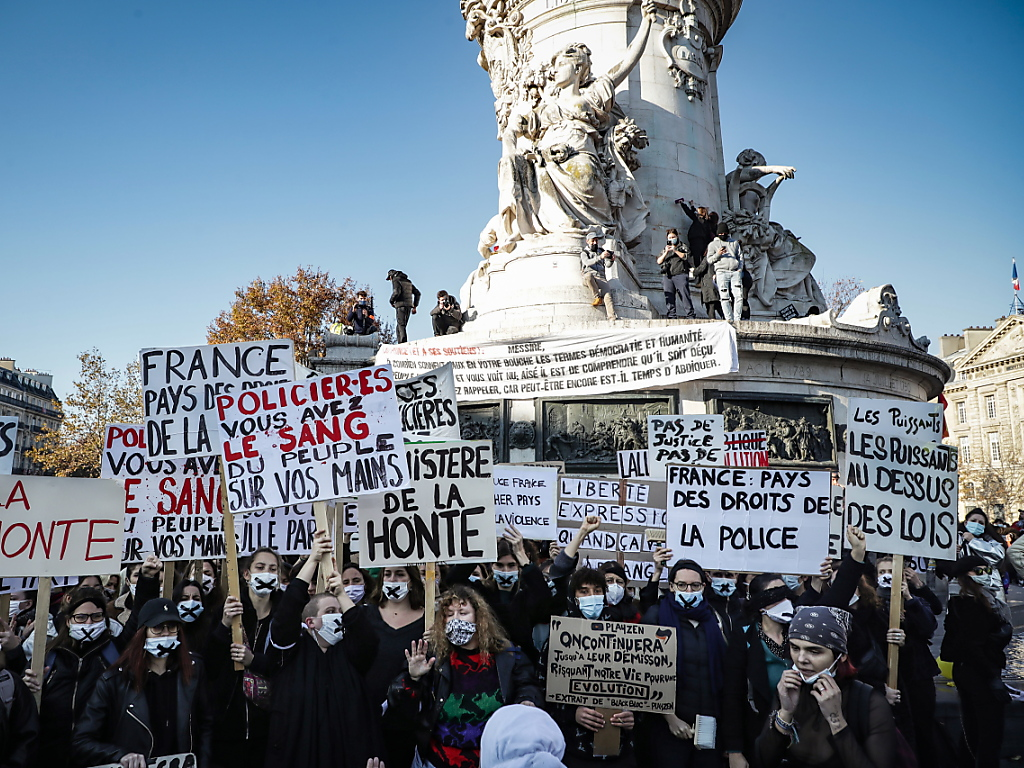 'Democracy bludgeoned': French protesters rally against police violence